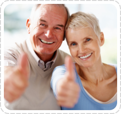 an old couple doing two thumbs-up